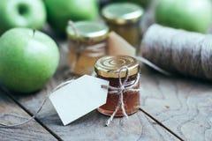 λευκό φωτογραφιών μαρμελάδας ανασκόπησης μήλων Στοκ Εικόνες