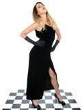 Ευμετάβλητη νέα γυναίκα που φορά το μαύρο φόρεμα Στοκ Φωτογραφία