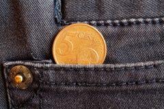 Ευρο- νόμισμα με μια μετονομασία 5 ευρο- σεντ στην τσέπη των γκρίζων τζιν τζιν Στοκ Εικόνα