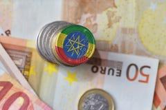 Ευρο- νόμισμα με τη εθνική σημαία της Αιθιοπίας στο ευρο- υπόβαθρο τραπεζογραμματίων χρημάτων Στοκ Εικόνα