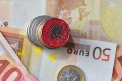 Ευρο- νόμισμα με τη εθνική σημαία της Αλβανίας στο ευρο- υπόβαθρο τραπεζογραμματίων χρημάτων Στοκ φωτογραφία με δικαίωμα ελεύθερης χρήσης
