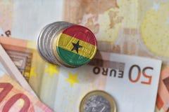 Ευρο- νόμισμα με τη εθνική σημαία της Γκάνας στο ευρο- υπόβαθρο τραπεζογραμματίων χρημάτων Στοκ εικόνα με δικαίωμα ελεύθερης χρήσης