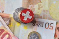 Ευρο- νόμισμα με τη εθνική σημαία της Ελβετίας στο ευρο- υπόβαθρο τραπεζογραμματίων χρημάτων Στοκ Φωτογραφίες