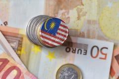 Ευρο- νόμισμα με τη εθνική σημαία της Μαλαισίας στο ευρο- υπόβαθρο τραπεζογραμματίων χρημάτων Στοκ φωτογραφία με δικαίωμα ελεύθερης χρήσης