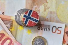 Ευρο- νόμισμα με τη εθνική σημαία της Νορβηγίας στο ευρο- υπόβαθρο τραπεζογραμματίων χρημάτων Στοκ Φωτογραφίες