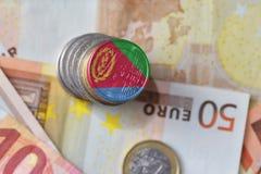 Ευρο- νόμισμα με τη εθνική σημαία της Eritrea στο ευρο- υπόβαθρο τραπεζογραμματίων χρημάτων Στοκ Εικόνες