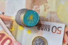 Ευρο- νόμισμα με τη εθνική σημαία του Καζακστάν στο ευρο- υπόβαθρο τραπεζογραμματίων χρημάτων Στοκ εικόνες με δικαίωμα ελεύθερης χρήσης