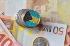 Ευρο- νόμισμα με τη εθνική σημαία των Μπαχαμών στο ευρο- υπόβαθρο τραπεζογραμματίων χρημάτων Στοκ εικόνα με δικαίωμα ελεύθερης χρήσης