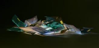 Ευρο- νόμισμα & x28 τραπεζογραμμάτια & x29  στην προστασία UV φωτός Στοκ Φωτογραφίες