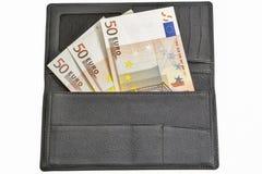 Ευρο- λογαριασμοί στο μαύρο πορτοφόλι δέρματος που απομονώνεται στο λευκό Στοκ εικόνα με δικαίωμα ελεύθερης χρήσης