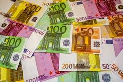 Ευρο- τραπεζογραμμάτια και μετρητά χρημάτων στοκ φωτογραφίες