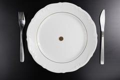 Ευρο- χρήματα νομισμάτων που τρώνε την έννοια Τίποτα που τρώει Τρώγοντας τα χρήματα στοκ εικόνες