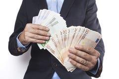 Ευρώ εκμετάλλευσης και στα δύο χέρια Στοκ Φωτογραφία