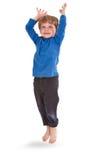 ευτυχές άλμα αγοριών ανα&sig Στοκ εικόνες με δικαίωμα ελεύθερης χρήσης