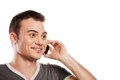 Ευτυχές άτομο που απαντά στο τηλέφωνο που απομονώνεται στοκ φωτογραφία με δικαίωμα ελεύθερης χρήσης