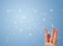 Ευτυχές δάχτυλο smileys με το κενό μπλε υπόβαθρο bokeh Στοκ εικόνα με δικαίωμα ελεύθερης χρήσης