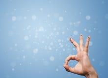 Ευτυχές δάχτυλο smileys με το κενό μπλε υπόβαθρο bokeh Στοκ εικόνες με δικαίωμα ελεύθερης χρήσης