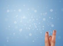 Ευτυχές δάχτυλο smileys με το κενό μπλε υπόβαθρο bokeh Στοκ φωτογραφία με δικαίωμα ελεύθερης χρήσης