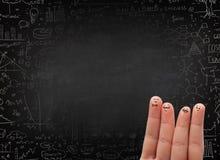 Ευτυχές δάχτυλο smileys με το μαύρο πίνακα κιμωλίας στο υπόβαθρο Στοκ Εικόνες