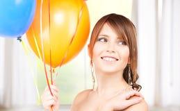 Ευτυχές έφηβη με τα μπαλόνια Στοκ εικόνα με δικαίωμα ελεύθερης χρήσης