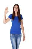 Ευτυχές έφηβη που κυματίζει έναν χαιρετισμό Στοκ φωτογραφία με δικαίωμα ελεύθερης χρήσης