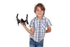 Ευτυχές αγόρι με τον κηφήνα του στοκ φωτογραφία