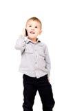 Ευτυχές αγόρι που μιλά στο τηλέφωνο Στοκ φωτογραφία με δικαίωμα ελεύθερης χρήσης