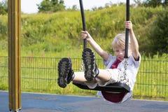Ευτυχές αγόρι στην παιδική χαρά Στοκ Φωτογραφίες
