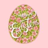 Ευτυχές αυγό Πάσχας με τα λουλούδια Στοκ Φωτογραφία