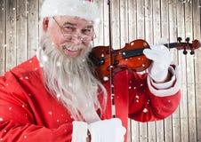 Ευτυχές βιολί παιχνιδιού santa Στοκ εικόνα με δικαίωμα ελεύθερης χρήσης