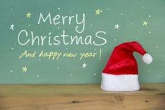 ευτυχές εύθυμο νέο έτος &Chi κόκκινο santa καπέλων Στοκ εικόνες με δικαίωμα ελεύθερης χρήσης