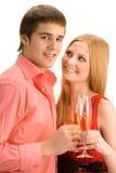 Ευτυχές ζεύγος με τη σαμπάνια στοκ εικόνα
