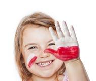 Ευτυχές κορίτσι ανεμιστήρων με τα χρωματισμένα χέρια Στοκ Εικόνα