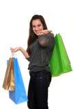 Ευτυχές κορίτσι με τις τσάντες αγορών στοκ εικόνες
