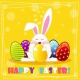 Ευτυχές κουνέλι εστέρα και πολύχρωμα αυγά Στοκ Φωτογραφία