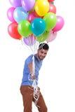 Ευτυχές περιστασιακό άτομο που δίνει μακριά μια δέσμη των baloons Στοκ φωτογραφίες με δικαίωμα ελεύθερης χρήσης