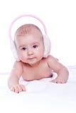 ευτυχές ροζ ακουστικών Στοκ φωτογραφία με δικαίωμα ελεύθερης χρήσης