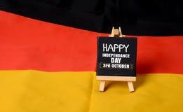 Ευτυχές στις 3 Οκτωβρίου ημέρας της ανεξαρτησίας της Γερμανίας στη σημαία Στοκ Φωτογραφία