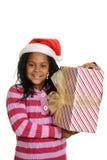 Ευτυχές τζαμαϊκανό παιδί με το χριστουγεννιάτικο δώρο Στοκ Φωτογραφία