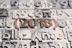 Ευτυχές το 2018 μεταξύ άλλων τύπων Τύπων Στοκ Φωτογραφίες