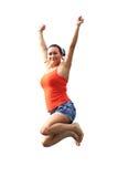 Ευτυχές brunette που πηδά στο τραμπολίνο στοκ εικόνες