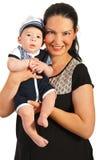 Ευτυχής γιος μωρών εκμετάλλευσης mom Στοκ εικόνα με δικαίωμα ελεύθερης χρήσης