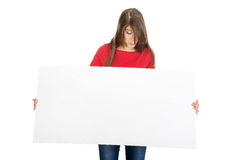 Ευτυχής γυναίκα που κρατά το κενό έμβλημα Στοκ Εικόνα