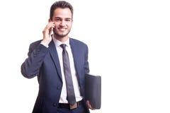Ευτυχής επιχειρηματίας με το τηλέφωνο και το φάκελλο Στοκ εικόνες με δικαίωμα ελεύθερης χρήσης