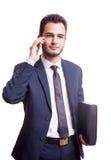 Ευτυχής επιχειρηματίας με το τηλέφωνο και το φάκελλο Στοκ φωτογραφία με δικαίωμα ελεύθερης χρήσης