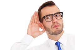 Ευτυχής επιχειρηματίας που ακούει κάτι Στοκ Φωτογραφία