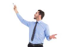 Ευτυχής επιχειρηματίας που δείχνει κάτι με το δείκτη Στοκ εικόνες με δικαίωμα ελεύθερης χρήσης