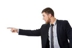 Ευτυχής επιχειρηματίας που δείχνει το δάχτυλό του Στοκ φωτογραφία με δικαίωμα ελεύθερης χρήσης