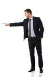 Ευτυχής επιχειρηματίας που δείχνει το δάχτυλό του Στοκ Εικόνα