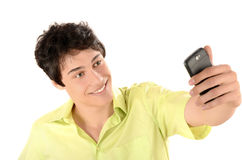 Ευτυχής επιχειρηματίας που παίρνει μια φωτογραφία selfie με το έξυπνο τηλέφωνό του. Στοκ Φωτογραφίες